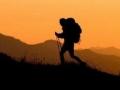 Sandy Weil and Karen Schooley hiking near Kool-Aid Lake at sunset, North Cascades, Washington, United States